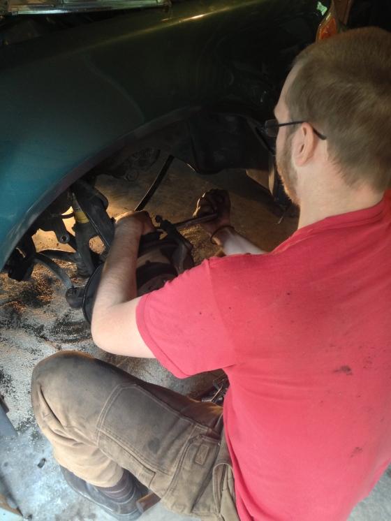 Scott working on his car.